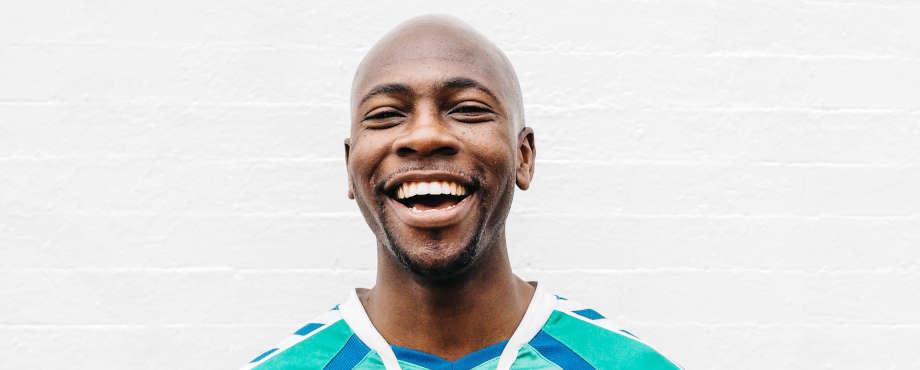 bald black man smiling