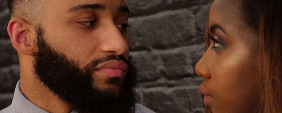 black man beard woman