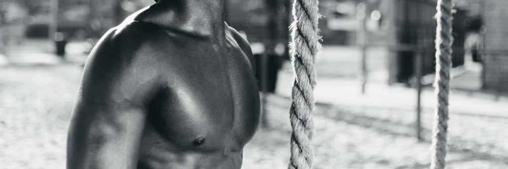 black mans body oiled