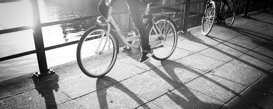 person cycling near river